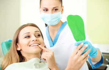Patient checking hers nee teeth