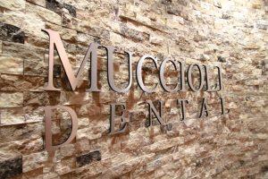 muccioli dental logo on the wall