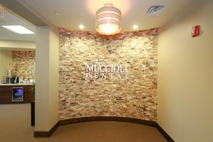 wall with muccioli dental logo