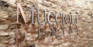 Muccioli Dental Logo on wall
