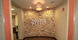 Muccioli Dental Logo on wall